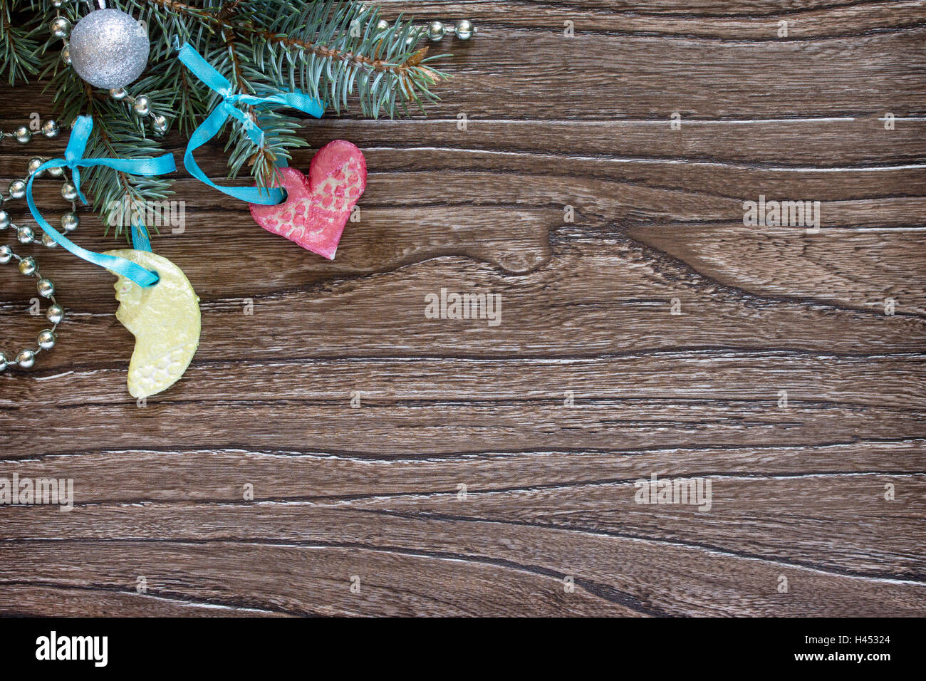 Christmas Frame Tree Branches And Toys Made Of Salt Dough On Wooden Background With Copy Space