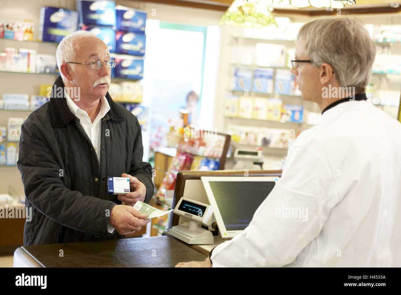 Man, senior, chemist's shop, Viagra, shop, pay, - Stock Image