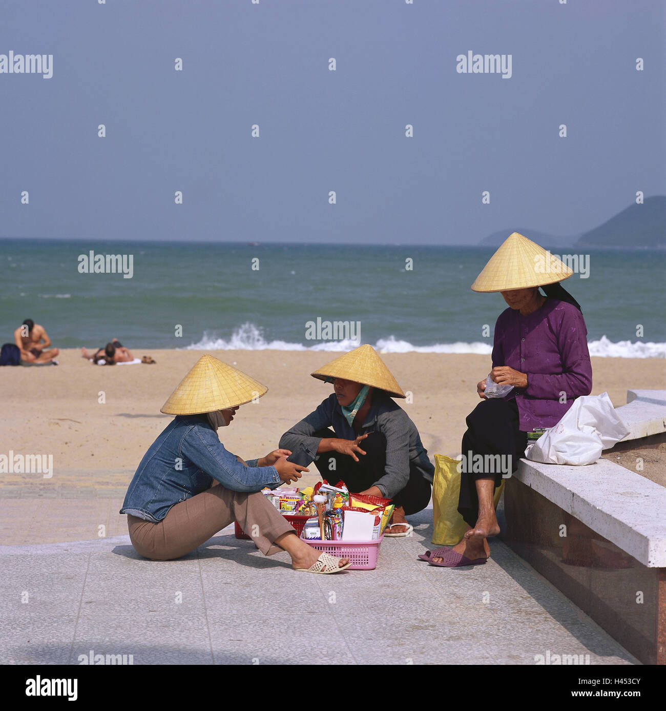 Vietnam, Nha Trang, beach, shop assistants, sit, conversation, no model release, Asia, South-East Asia, town, person, Stock Photo
