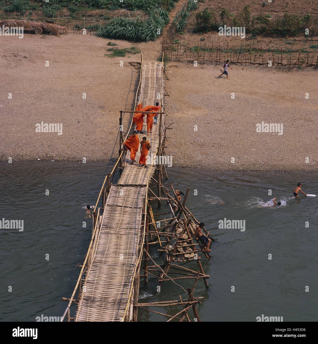 Laos, Luang Prabang, river Nam Khan, bridge, monks, children, have ...