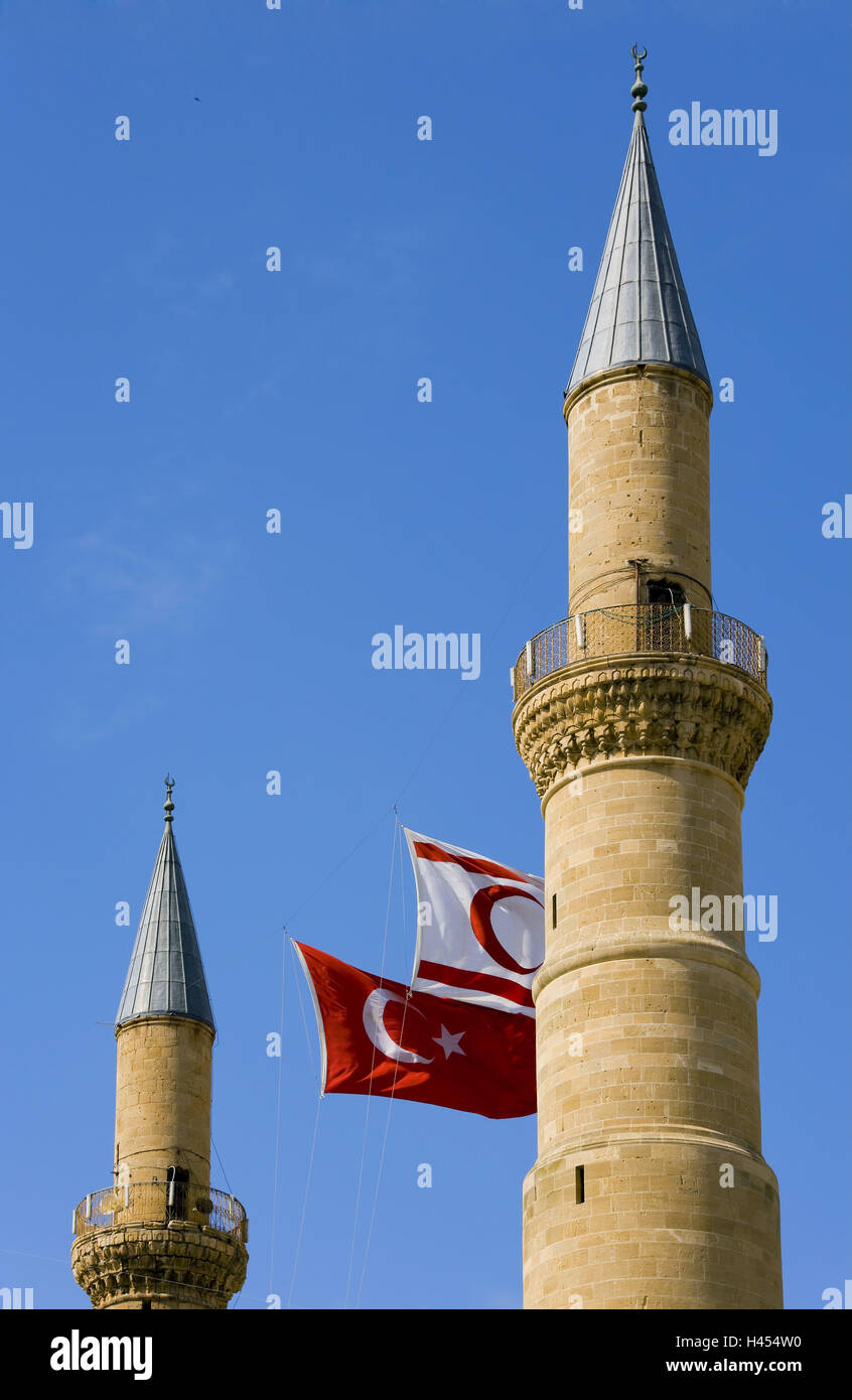 Cyprus, Nicosia, Selimiye mosque, detail, minarets, flags, in Turkish, - Stock Image