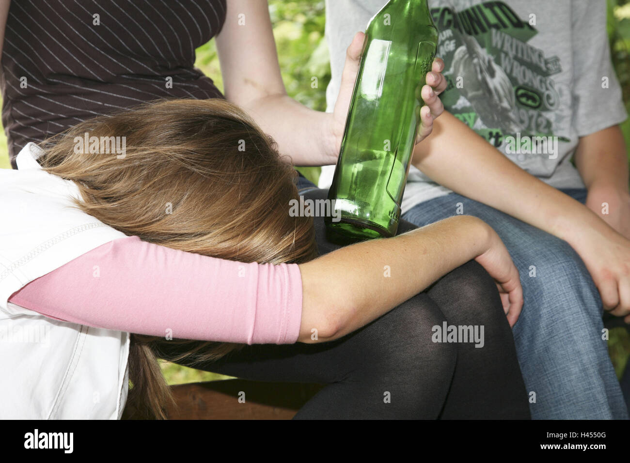 Young persons, girls, boy, sit, hold park-bench, schnapps Bottle, blank, there sleep, drunk, detail, model released, Stock Photo