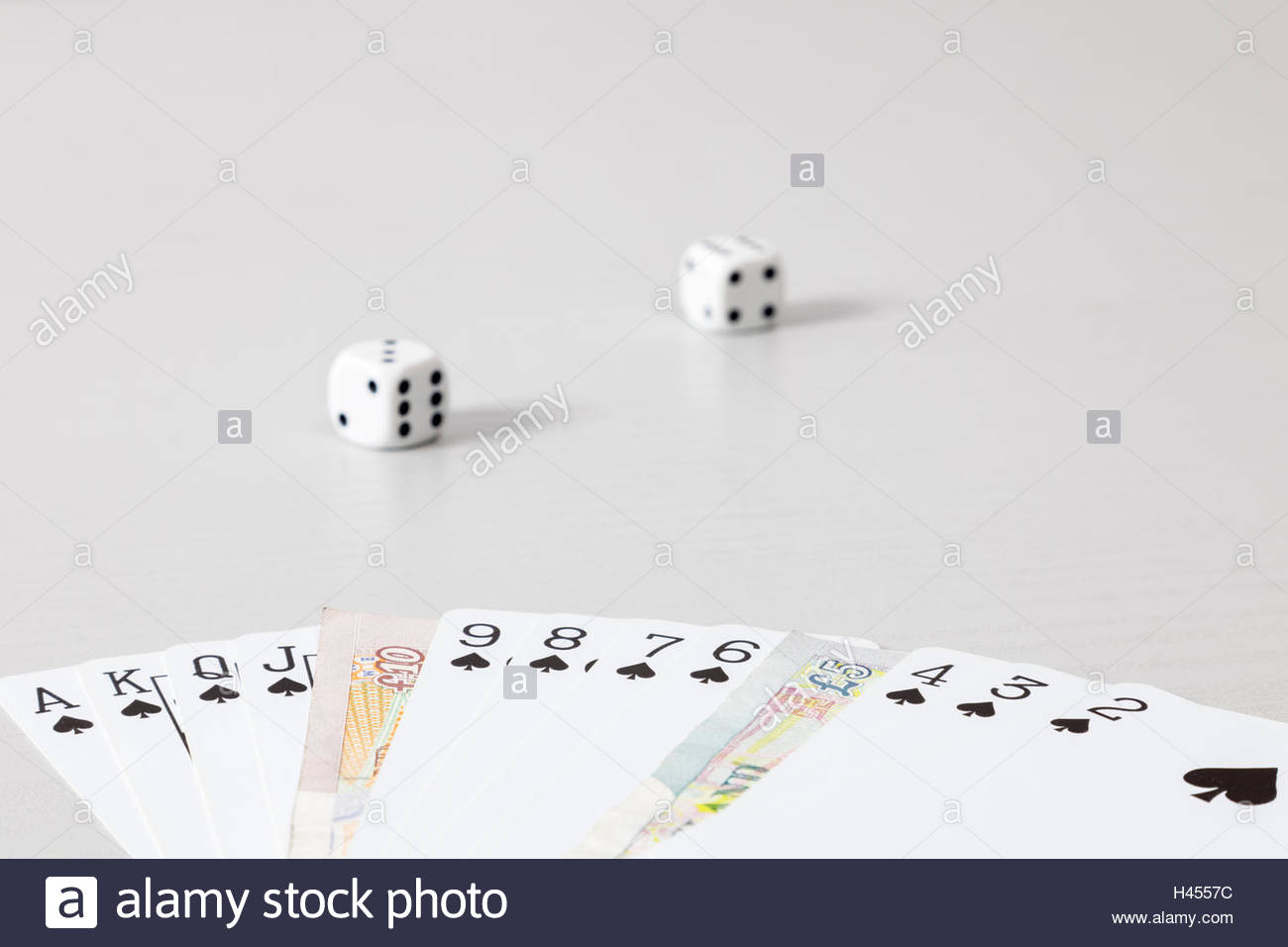 Full suit of spades with banknotes substitutes for some cards - Stock Image
