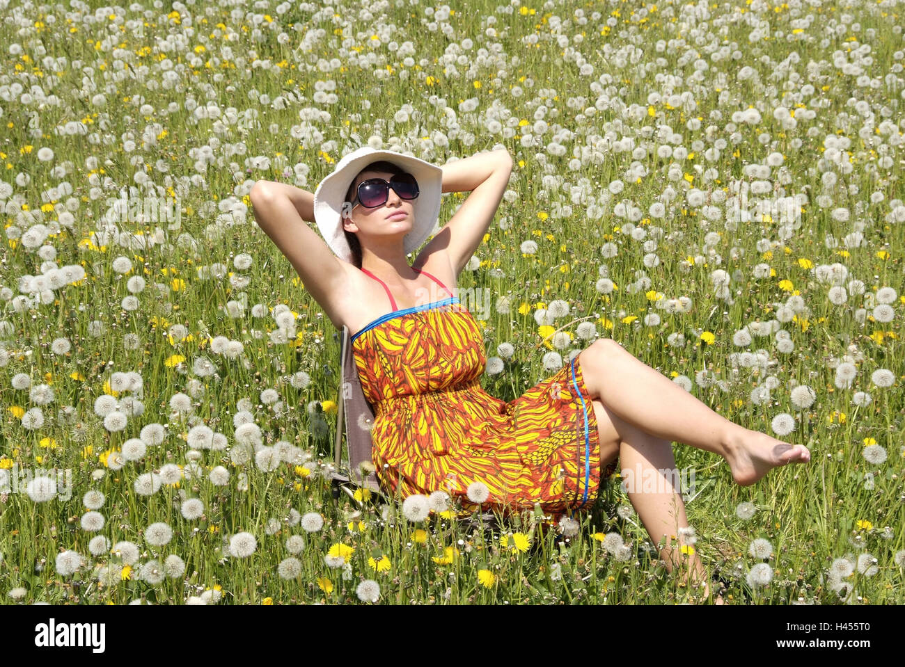 Woman, spring meadow, sitting, sunbath, relaxing, - Stock Image