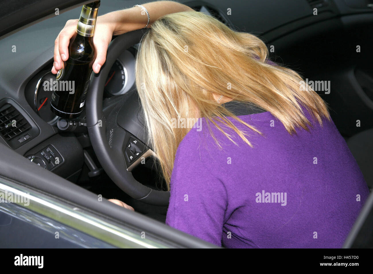 Woman, car, tax, alcoholizes, beer bottle, danger, traffic, - Stock Image