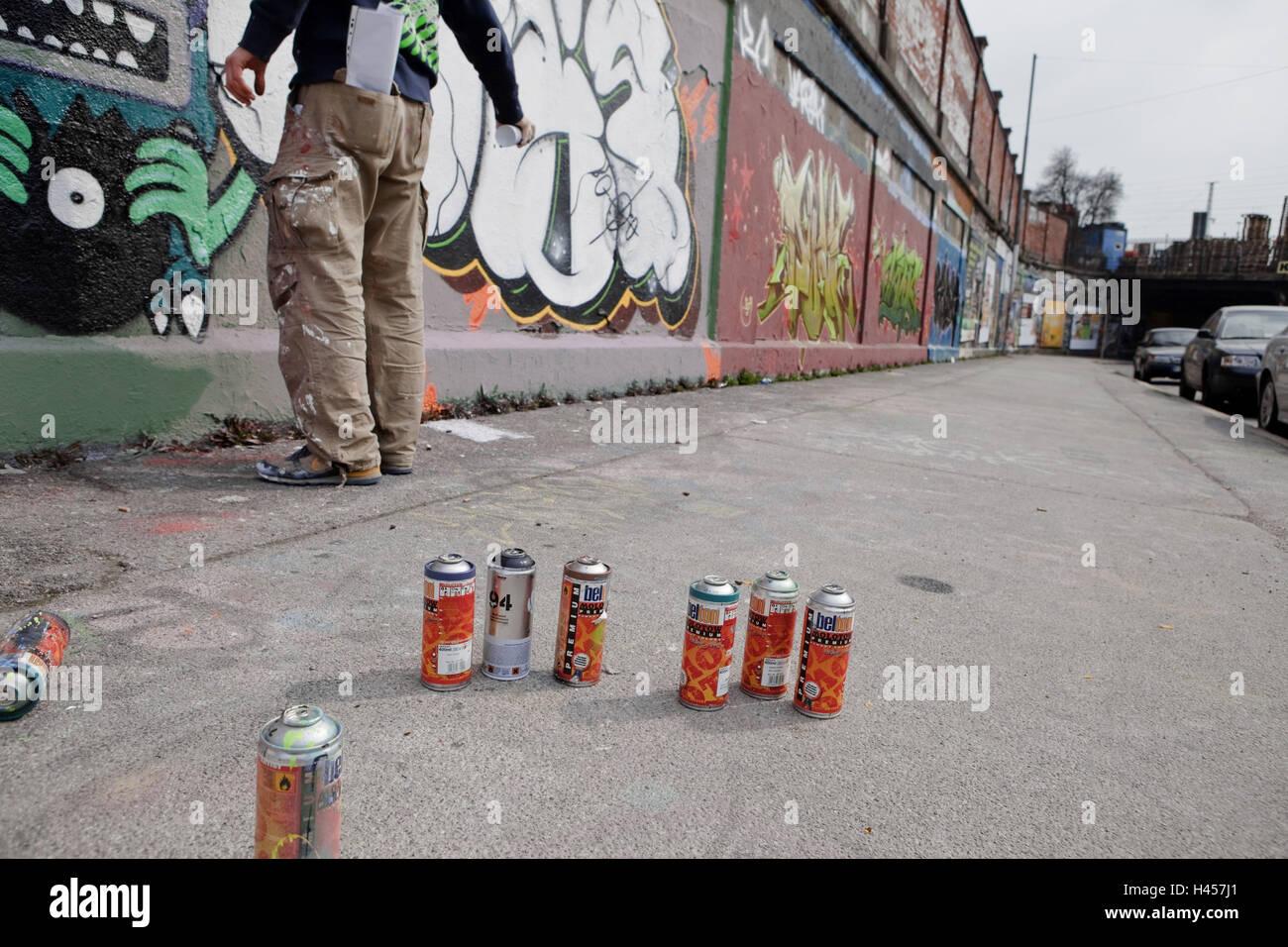 Sprayer, paint tins, wall, graffiti, - Stock Image