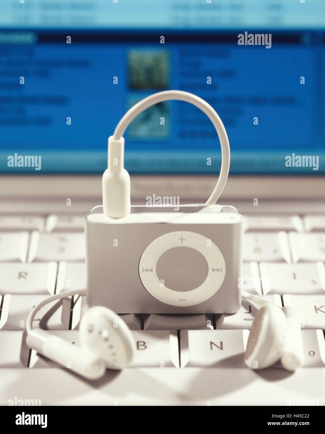 Laptop, keyboard, iPod shuffle, silver, ear-listeners, no property release, computers, Notebook, screen, computer - Stock Image