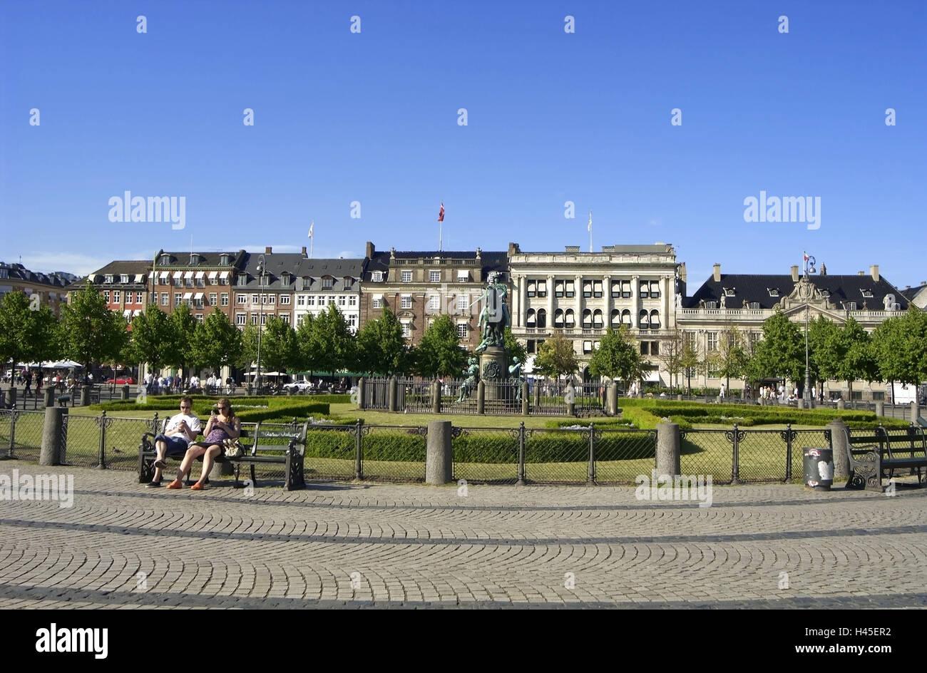 Denmark, Copenhagen, Kongens Nytorv, terrace, meadow, equestrian statue, park-bench, tourist, no model release, - Stock Image