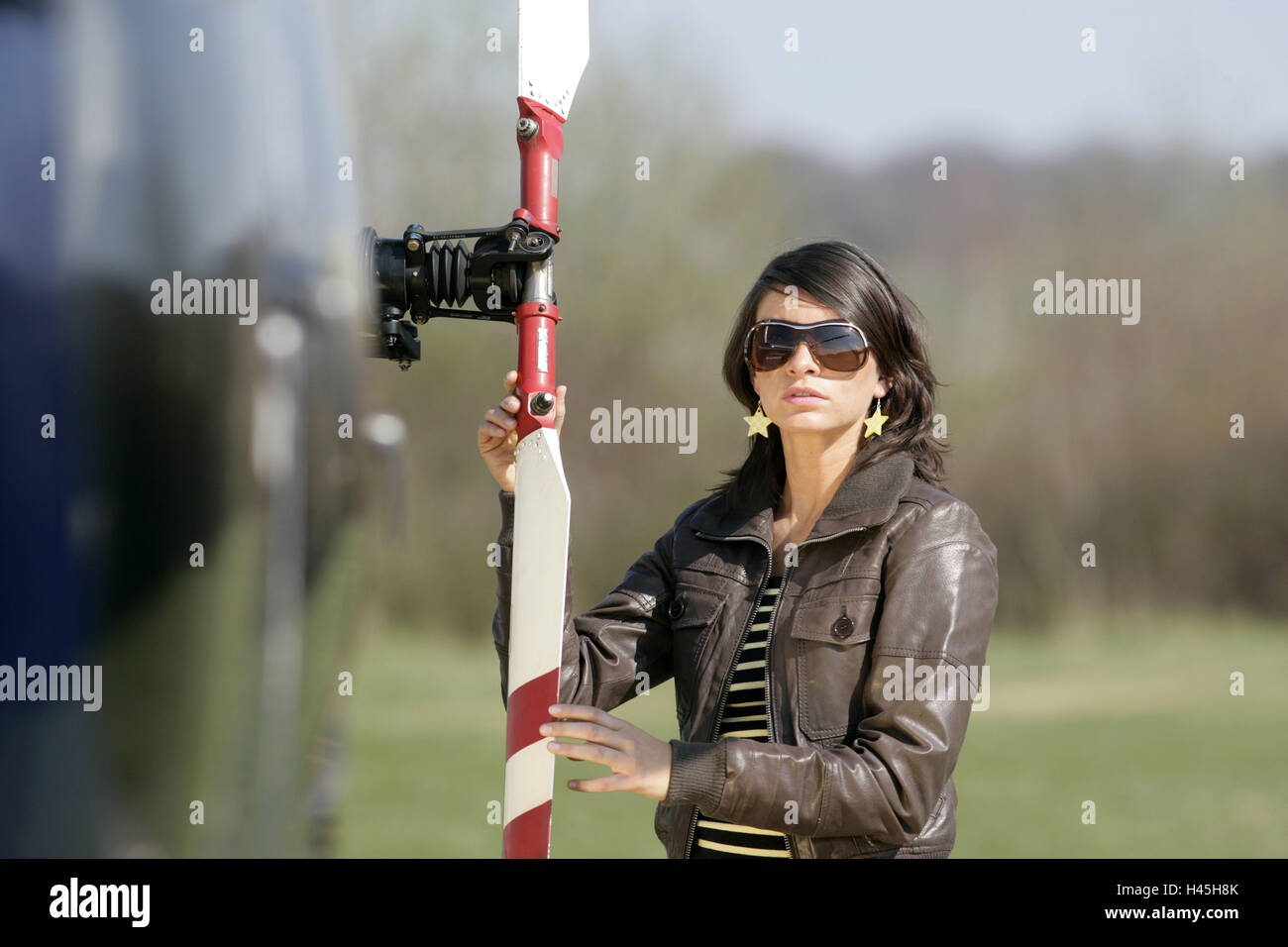 Woman, young, helicopters, rotor, stand, - Stock Image