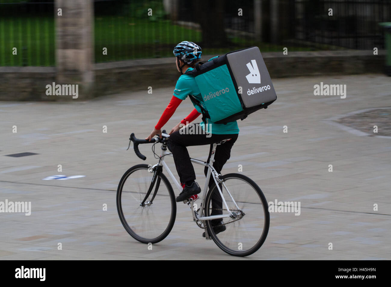 f8bdba06ec7 A Deliveroo cyclist from the increasingly popular hot food and fast food  delivery company cycling through