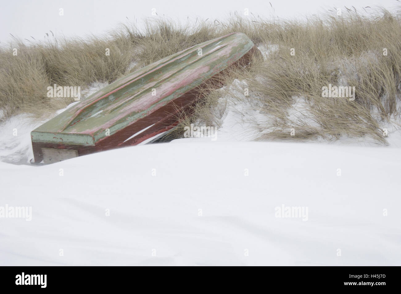 Germany, Mecklenburg-West Pomerania, island Hiddensee, fishing boat lies turned on the beach lying, winter, Stock Photo
