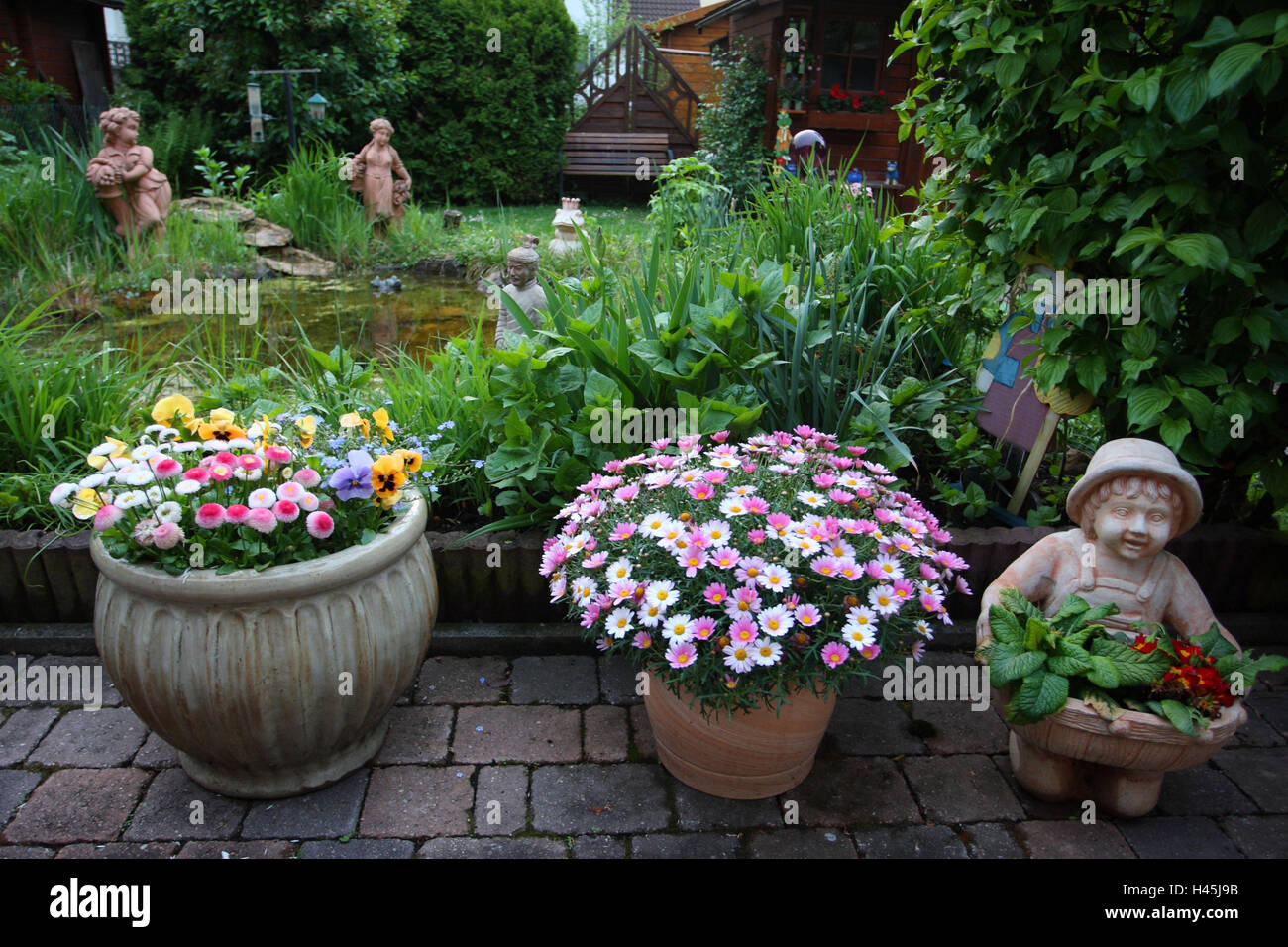 Superbe Garden With Flowers And Garden Figures,   Stock Image