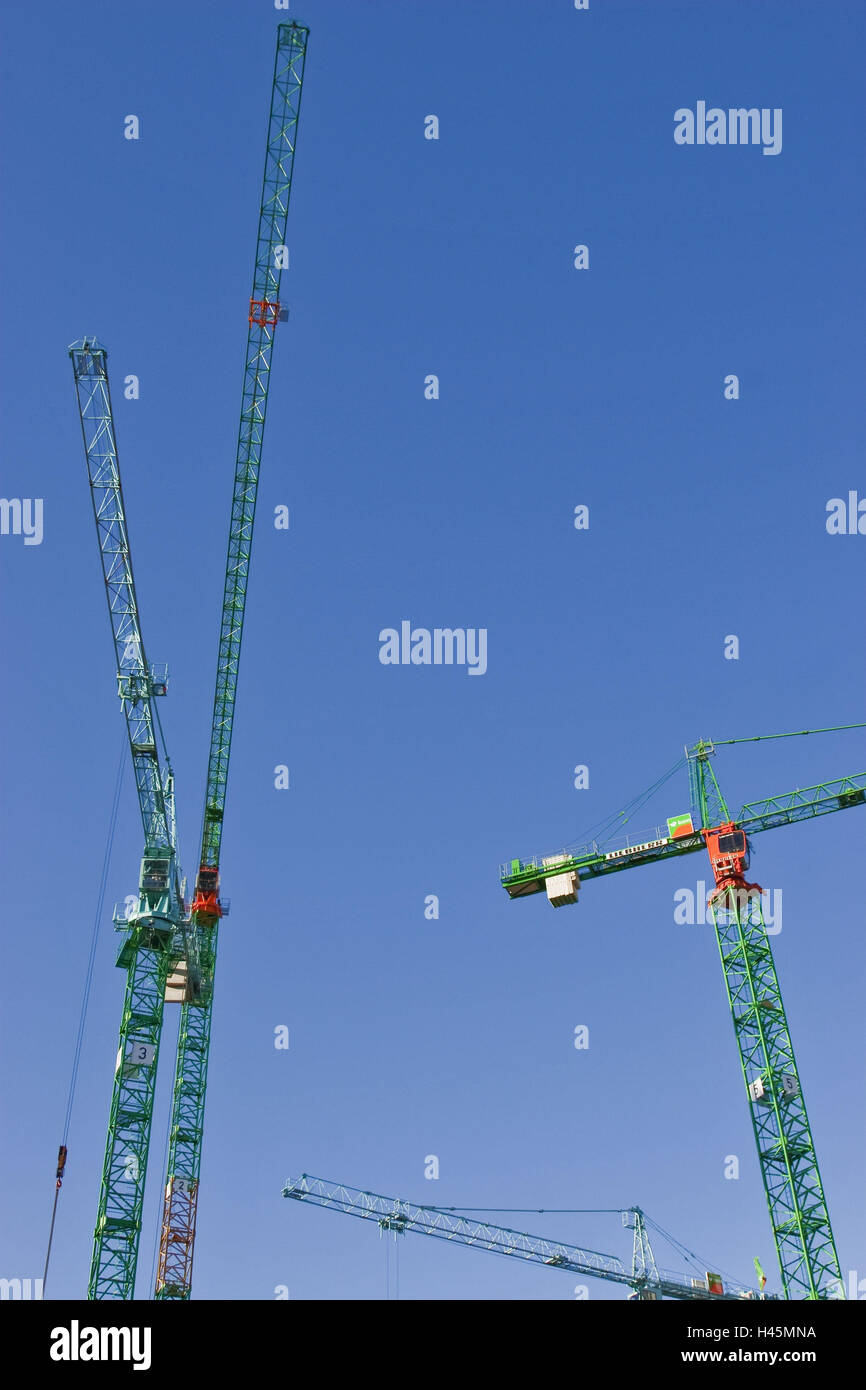 Men at work, construction cranes, from below, - Stock Image