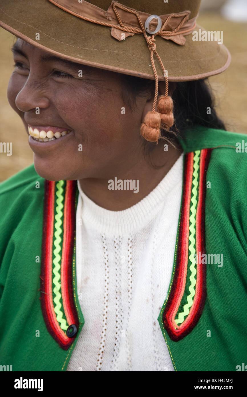 Peru, Titicacasee, Uros Iceland, Uro woman, smile, portrait, curled, South America, Bolivia, Titicaca lake, Uro - Stock Image