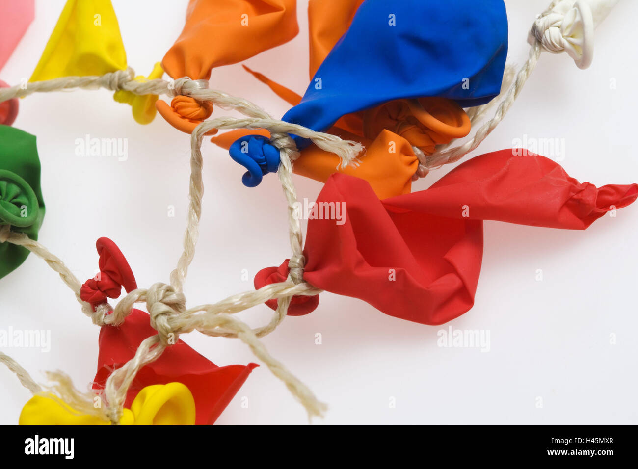 Balloons, bursts, cable, detail, studio, cut out, burst, balloons, play, colours, brightly, broken, children's - Stock Image