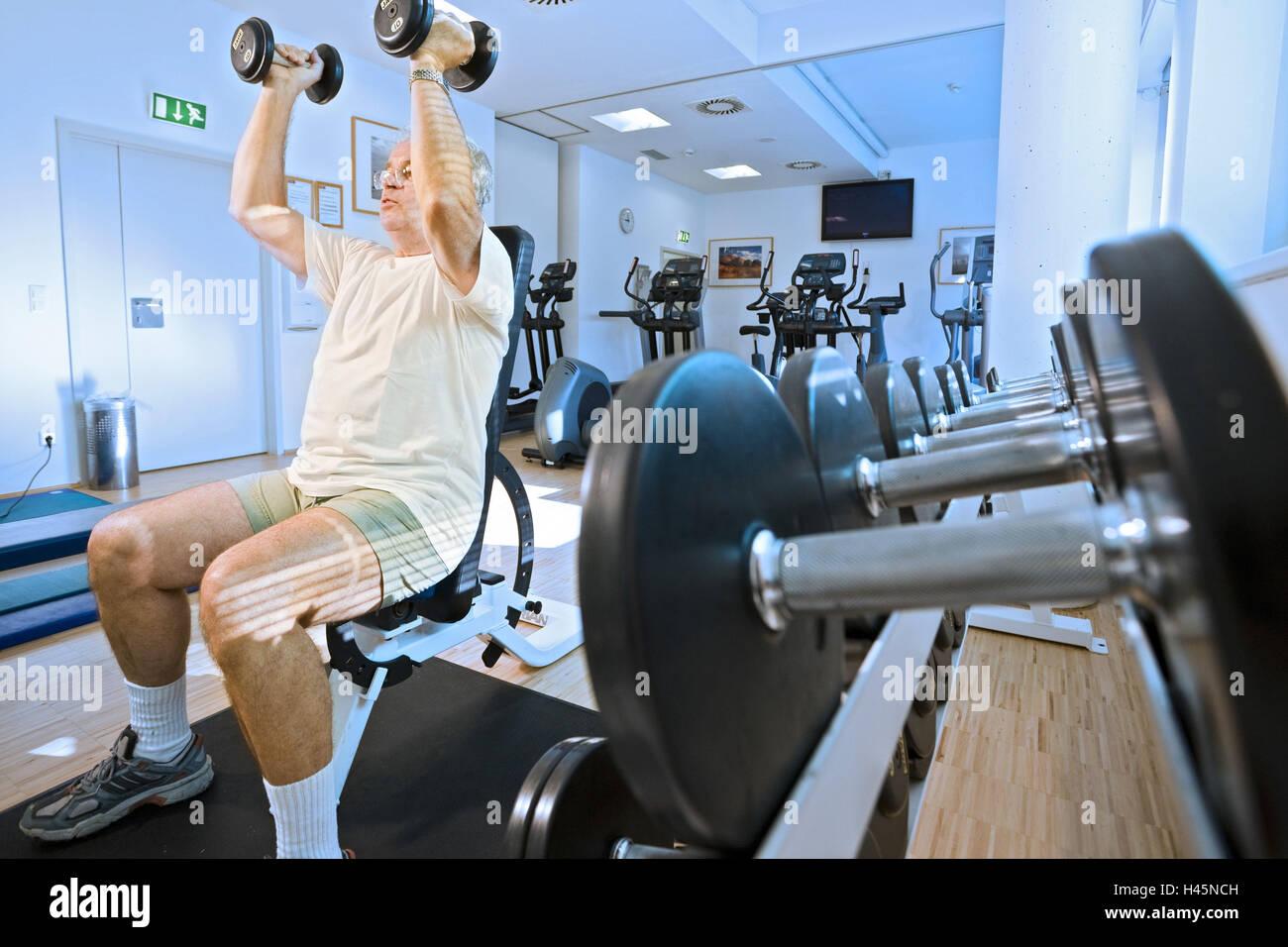Fitness studio, senior, dumbbell training, weights, practise, - Stock Image