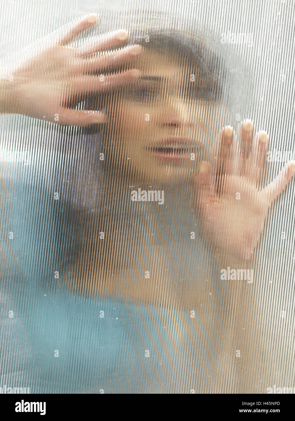 Woman, young, gesture, fear, panic, window, portrait, person, helplessly, desperation, isolation, Perspex slice, - Stock Image