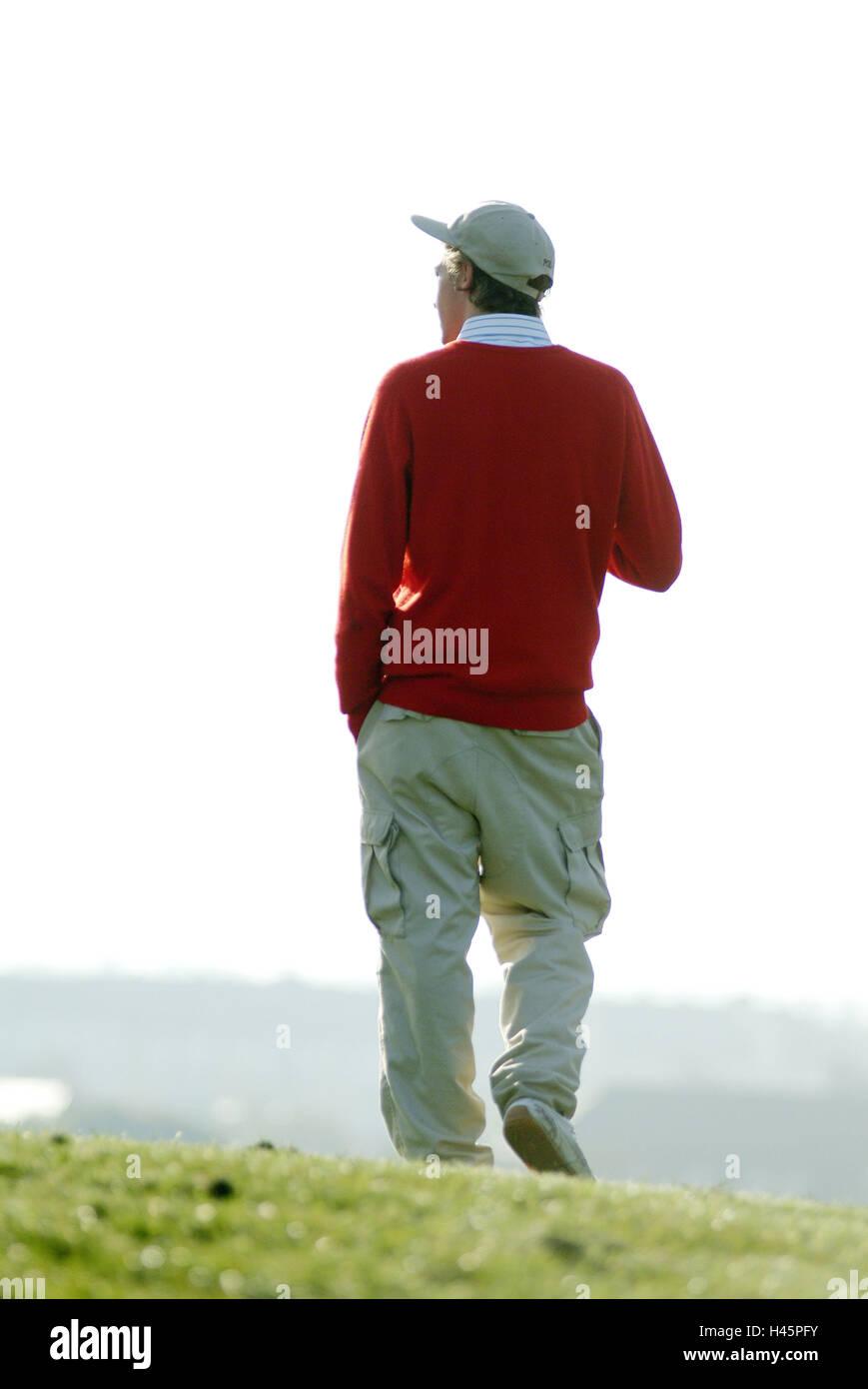 Man, young, walk, back opinion,,  Meadow, outlook,,   20-30 years, leisurewear, headgear, Basecap, hands, pants - Stock Image