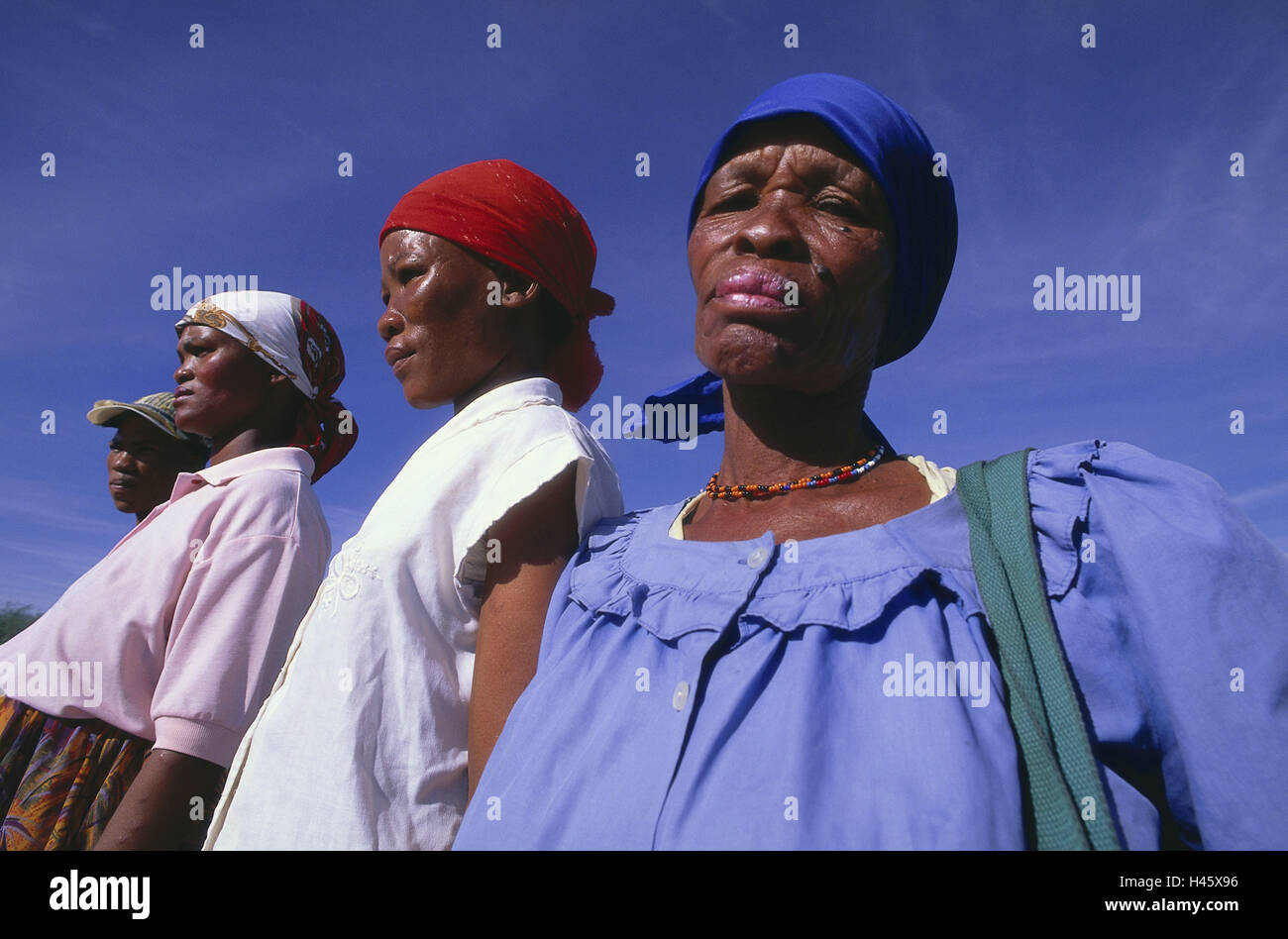 Botswana, women, portraits, clothes, brightly, clothes, headscarfs, headgear, locals, heavens, cloudless, blue, - Stock Image