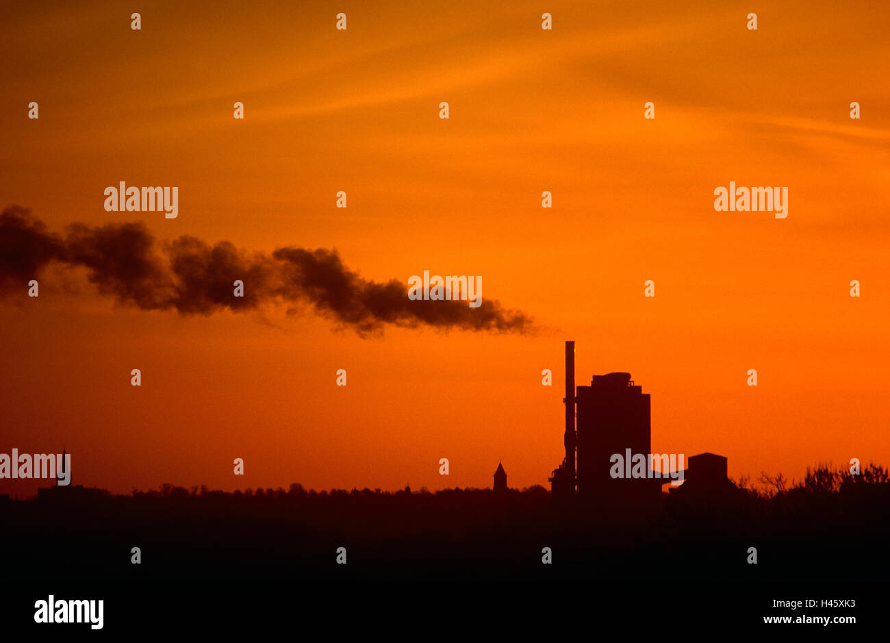 Sunset over industrial plot - Stock Image
