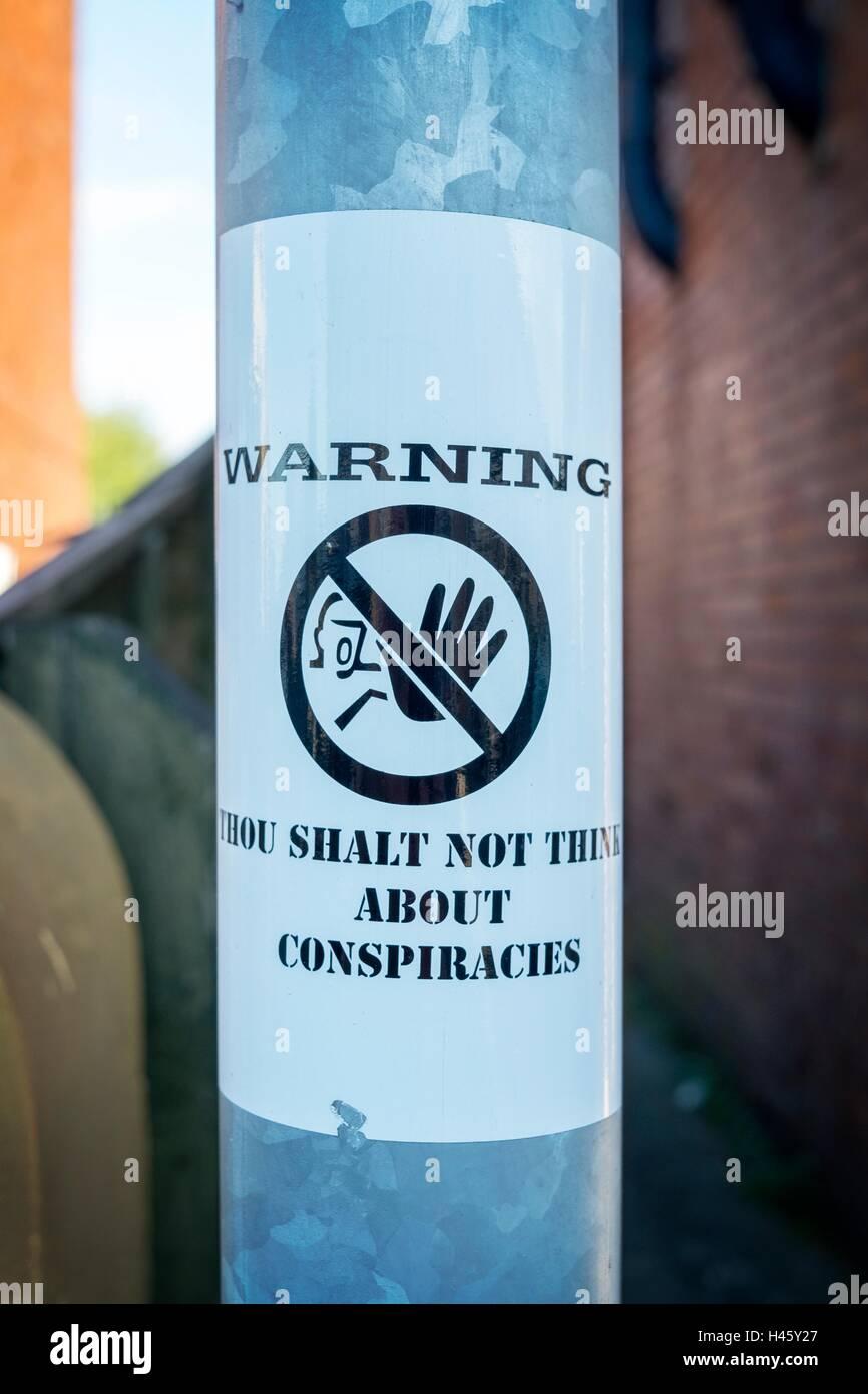 Warning Conspiracy theory spy spying listening watching secrets secret sticker on pole, Manchester, UK - Stock Image