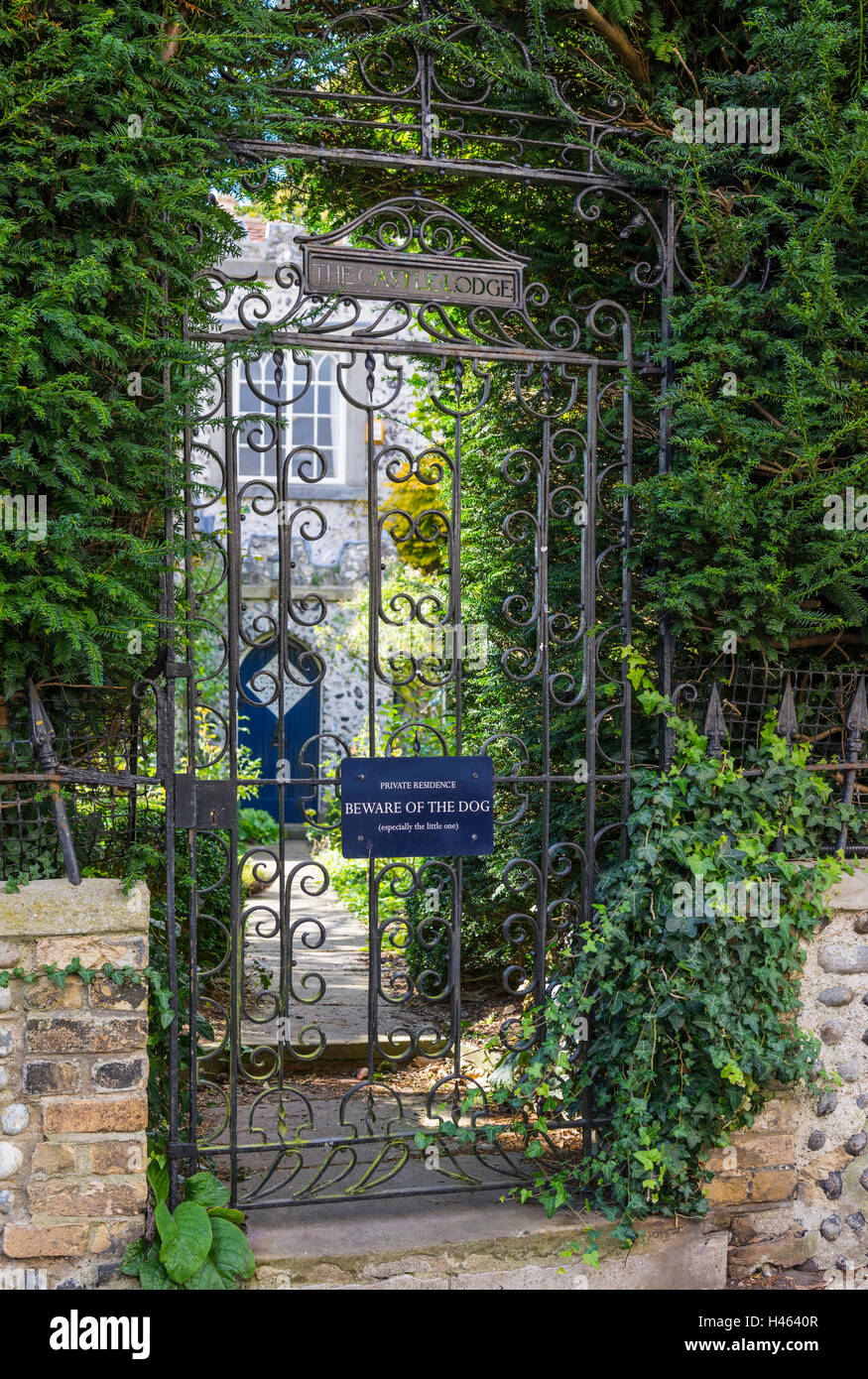 Beware of the dog sign on a metallic gate at private residence. - Stock Image