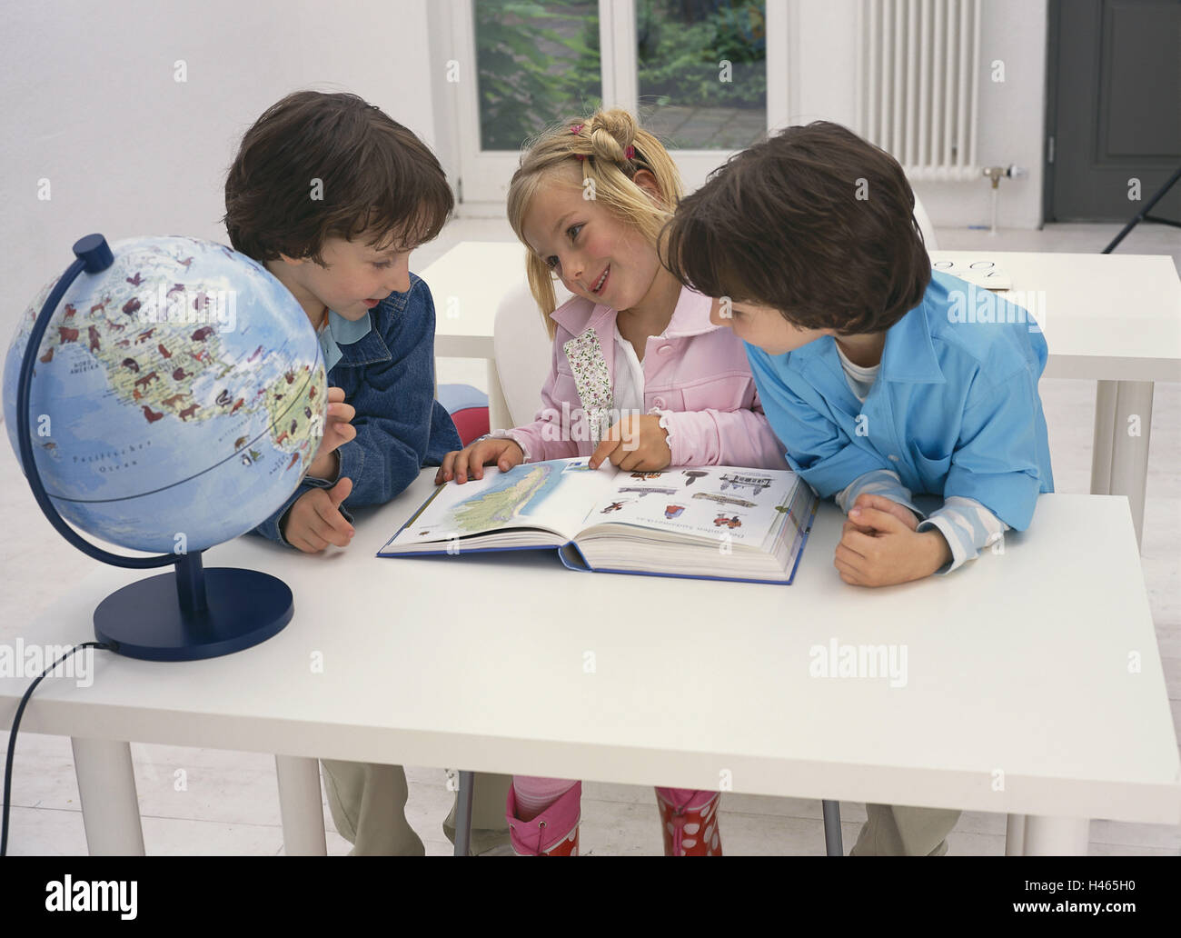 Classrooms, boys, girls, book, child globe, happy, school, school desk, person, children, three, twins, siblings, Stock Photo