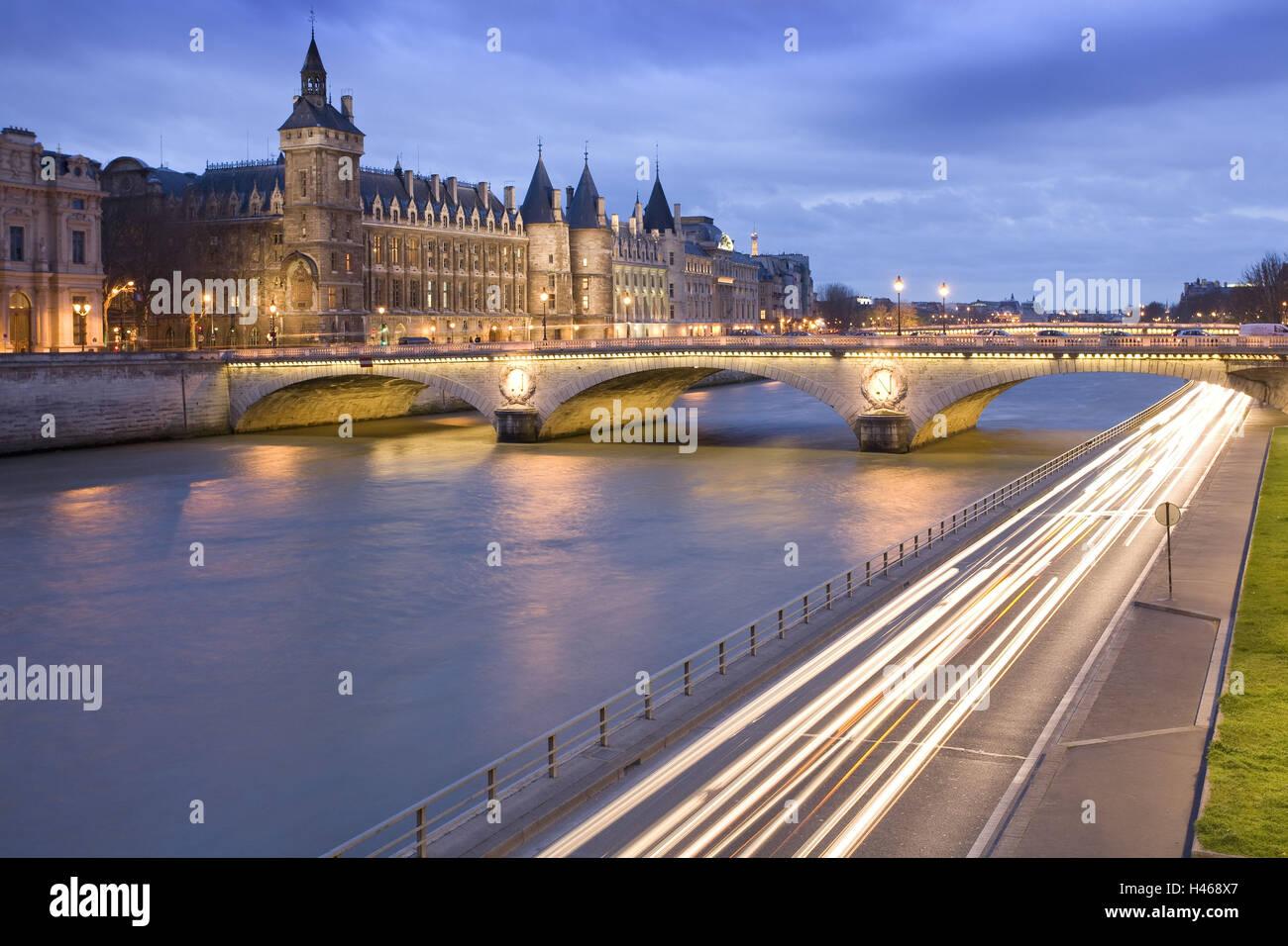 France, Paris, Palais de Justice, Conciergerie, Pont au Change, Seine, evening, street, light trails, - Stock Image