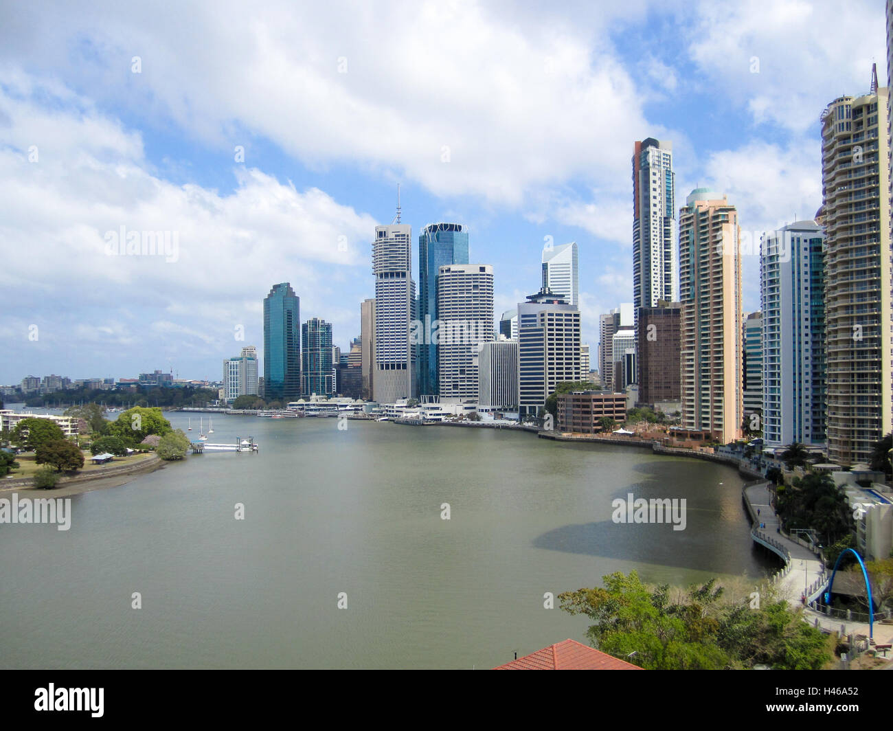 The dramatic high-rise buildings of Brisbane's central business district overlook the wide Brisbane River - Stock Image