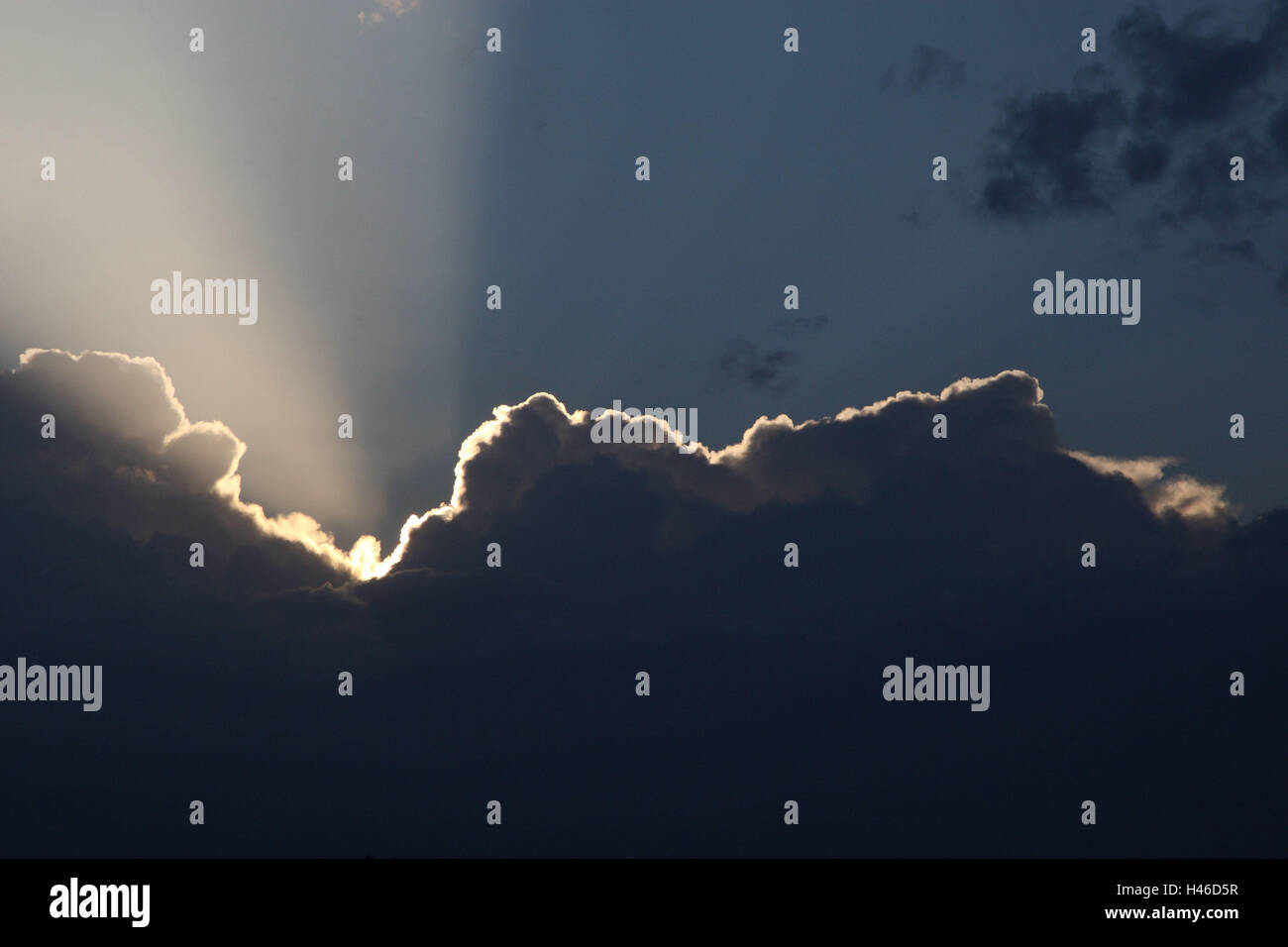 Clouds with sunrays in the Masai Mara, Africa, Kenya, - Stock Image