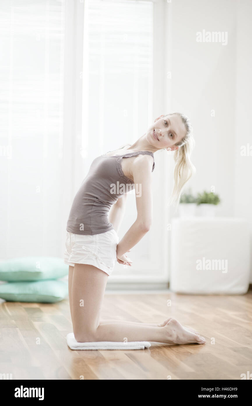 Young woman makes of a gymnastic practise, - Stock Image