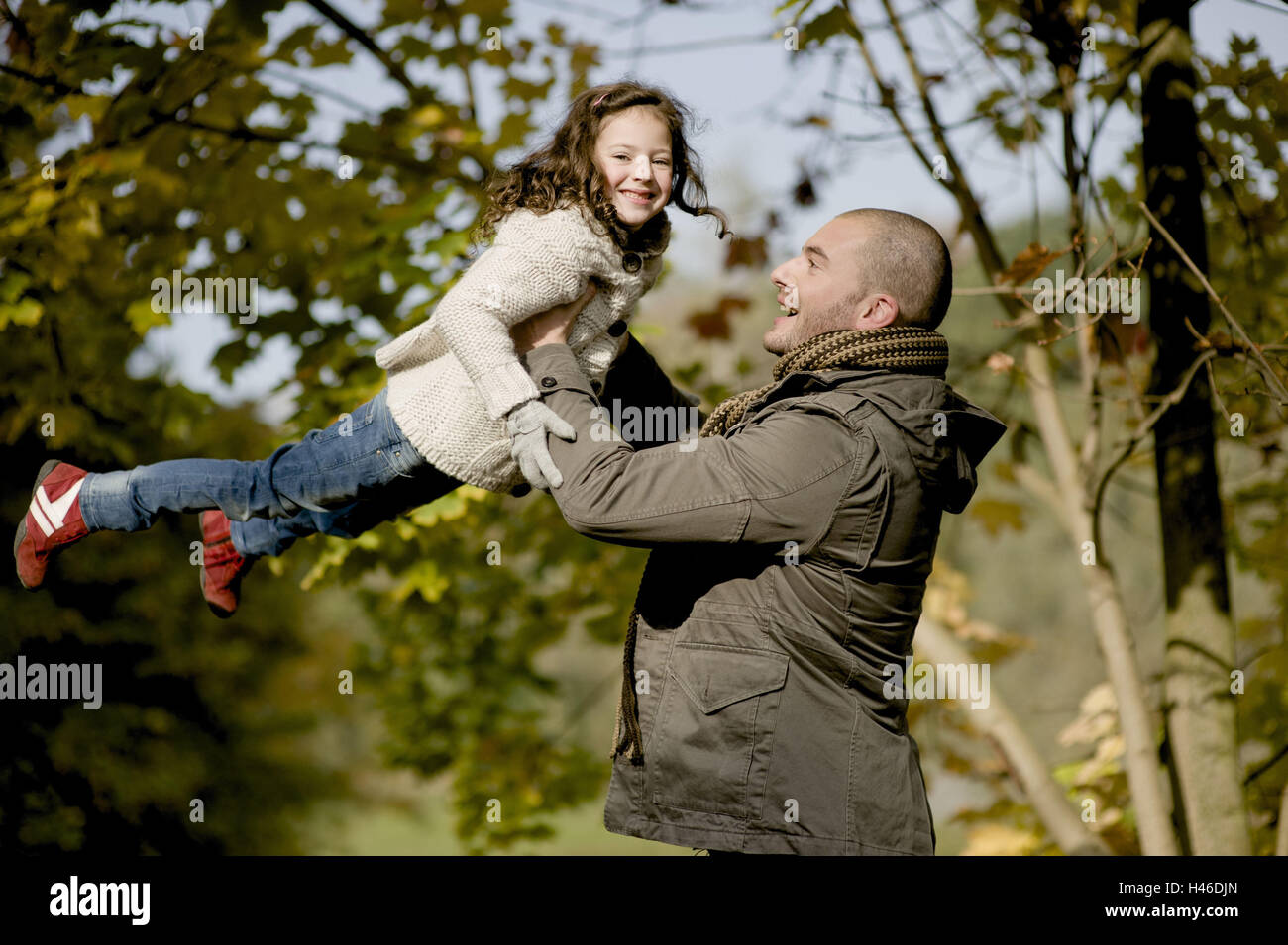 Father lifts subsidiary upwards, - Stock Image