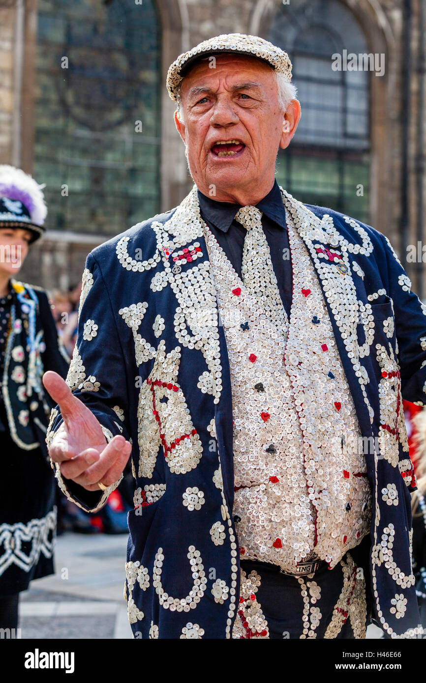 Pearly Kings and Queens Sing Traditional Songs At They Parade Around The Guildhall Yard, Harvest Festival, London, - Stock Image