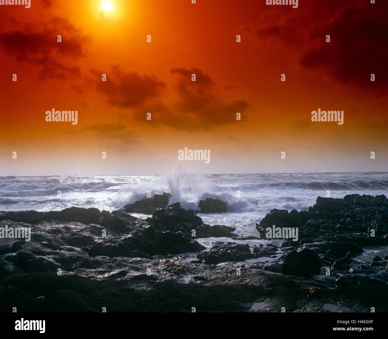 Sunset over sea rocks - Stock Image