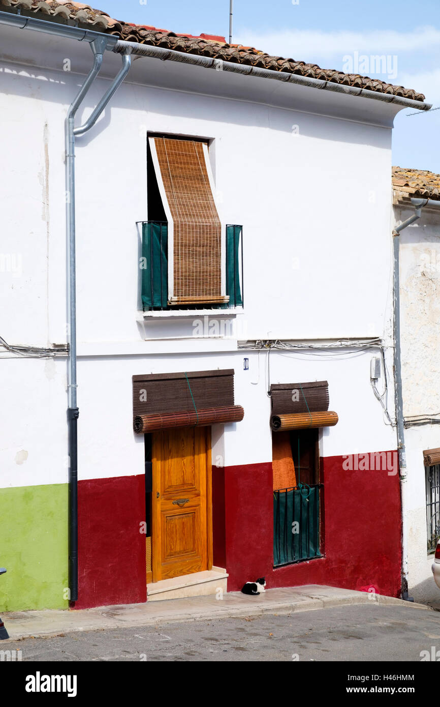 Roller Blinds Over The Windows And Doors Of A Typical Spanish Terrace House