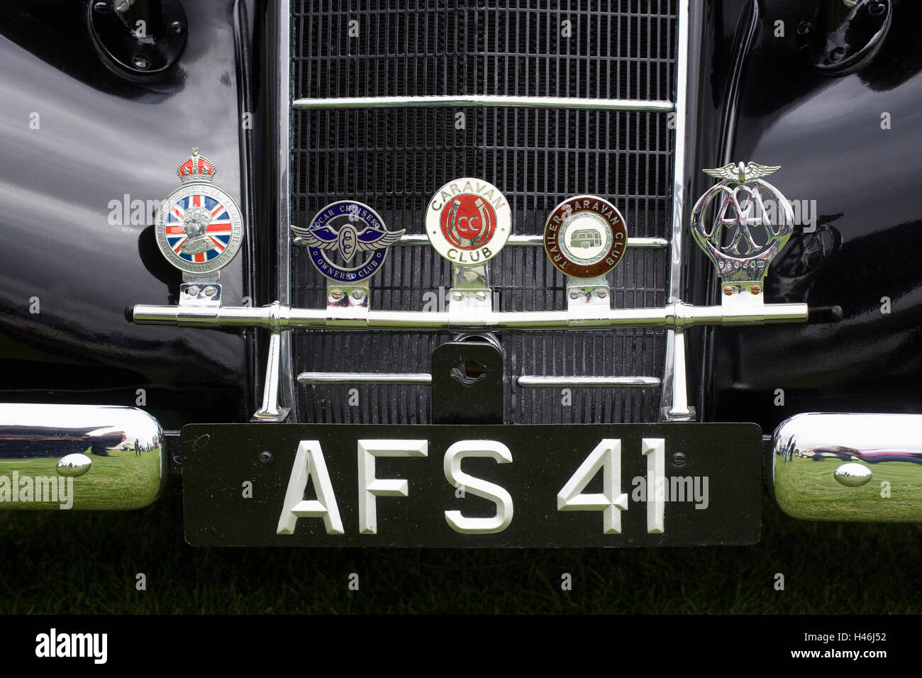 Car badges on the front of a 1936 Hillman 16. - Stock Image