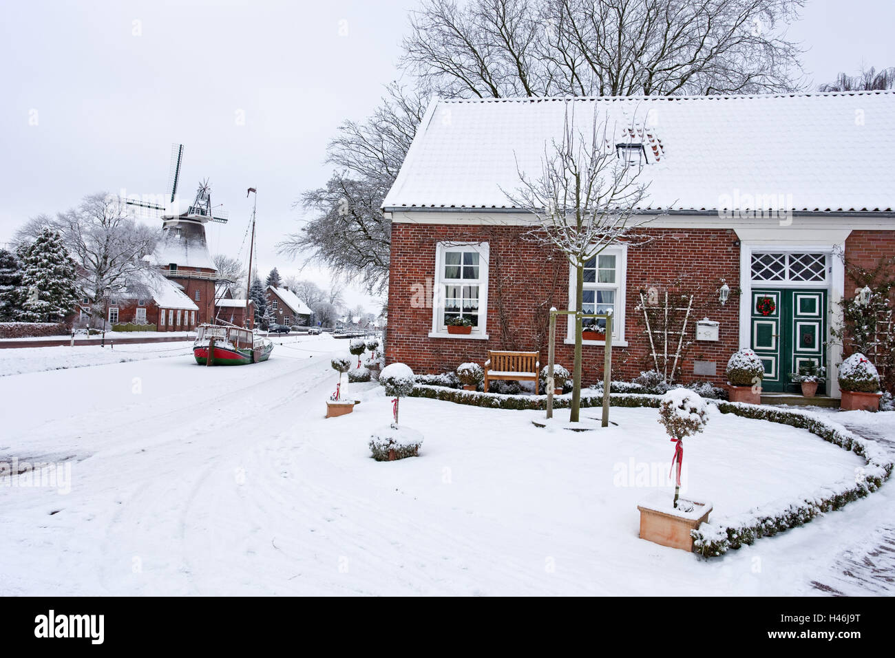 East Friesland, winter mood, house, boat, windmill, - Stock Image