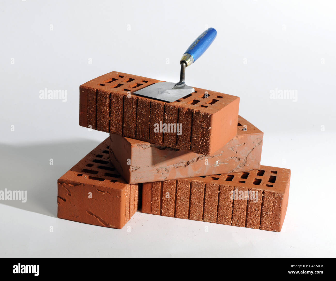 Red bricks, trowel, stones, red, stacked, about one another, on each other, transfers, build, based, construction - Stock Image
