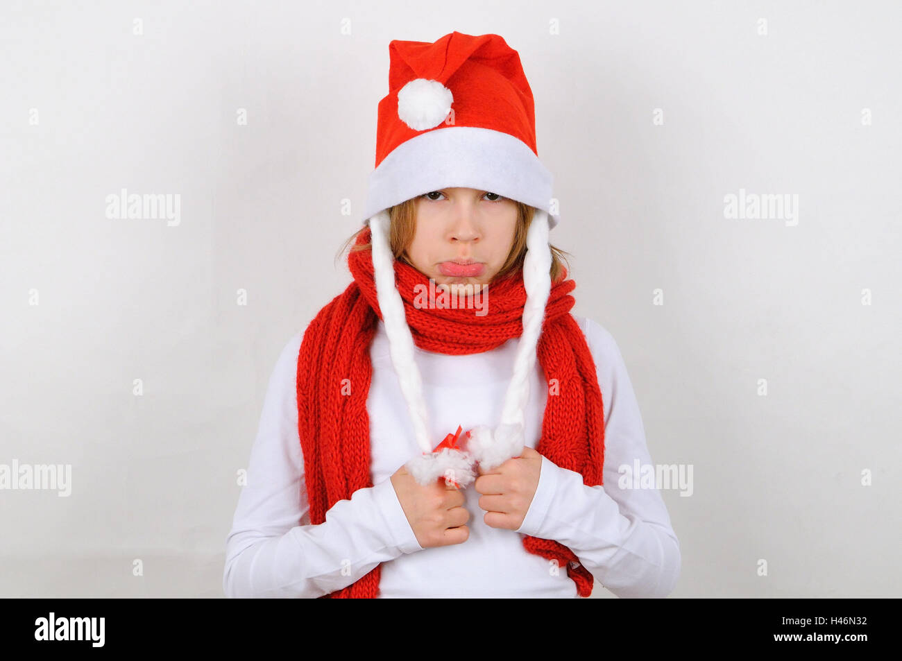 Girl, Santa's hat, view camera, defiantly, Christmas, winter, Santa, Santa's hat, person, child, scarf, red, gesture, Stock Photo