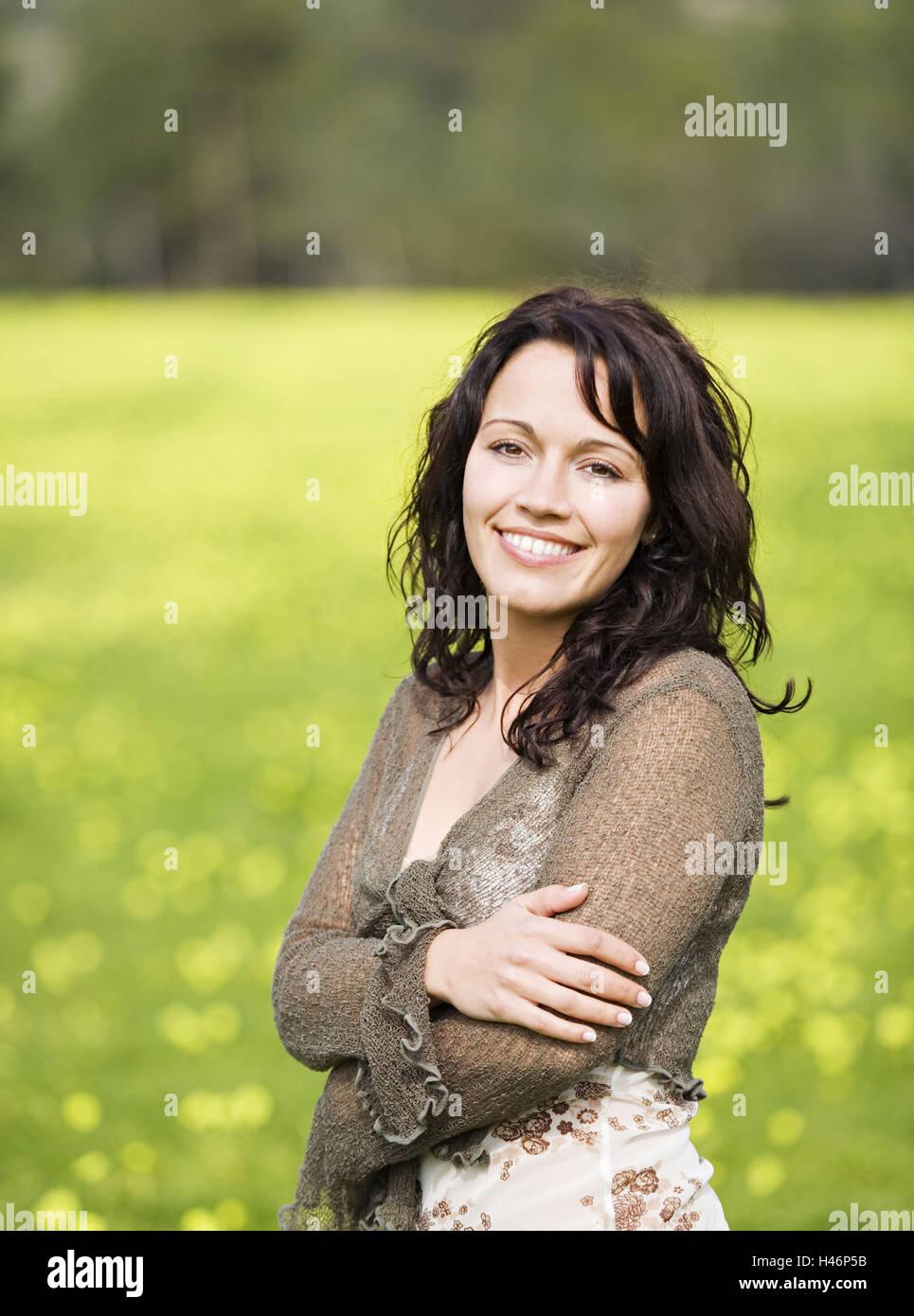 Woman, walk, spring meadow, fresh air, sunshine, enjoy, smile, half portrait, - Stock Image