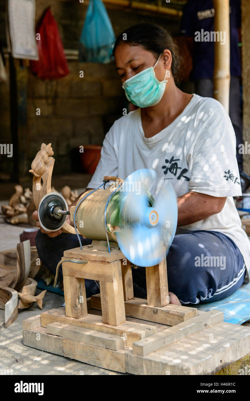 Woman working on fair trade handcraft - Stock Image