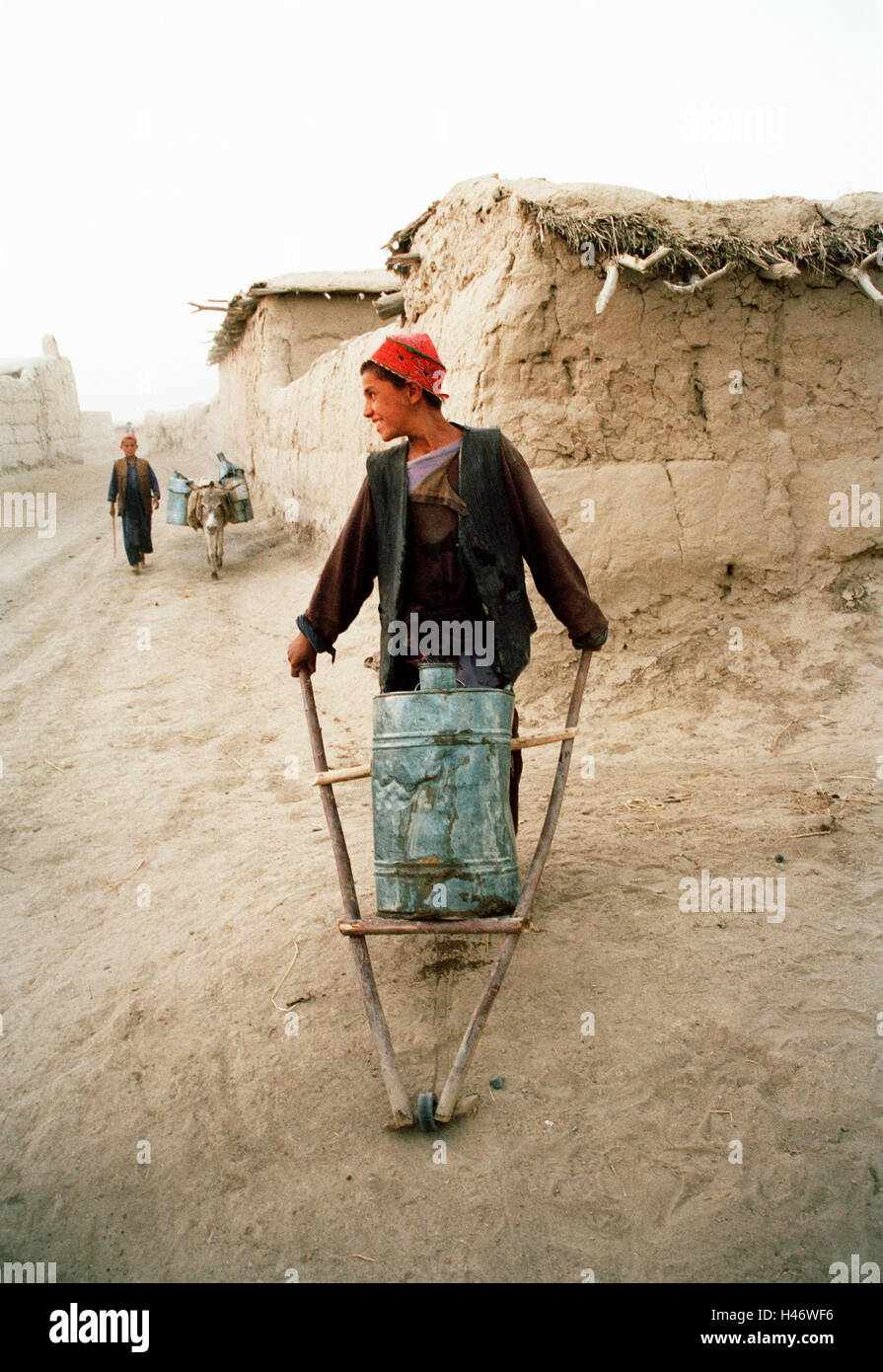 Afghanistan, boy, smile, carriage, barrel, - Stock Image