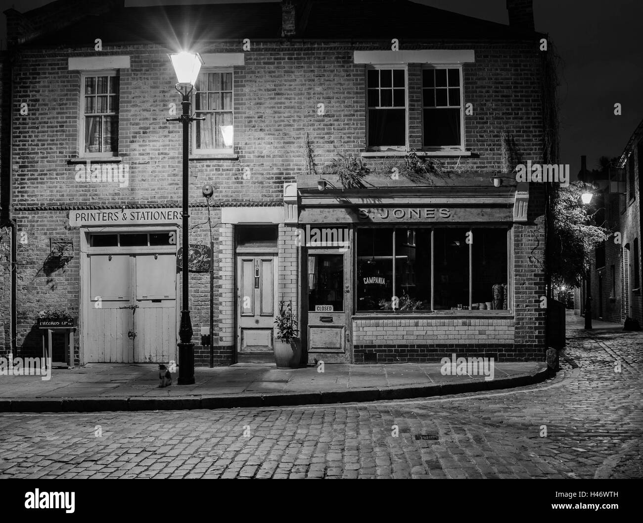 f7f89120c29 Victorian shop and business premises in old London with Victorian style  street lighting and a night