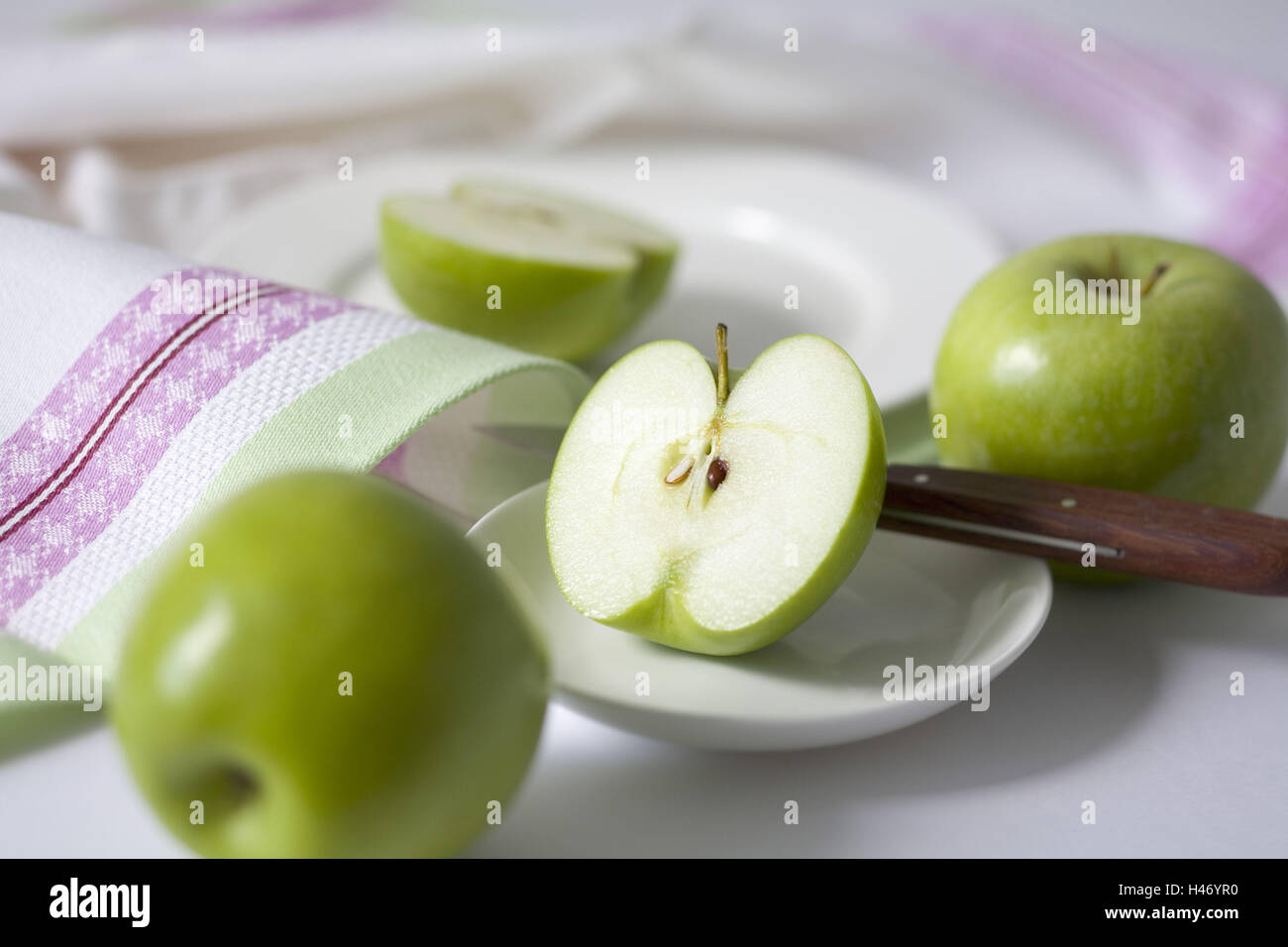 Two apples and a divided apple, sort 'Granny Smith', - Stock Image
