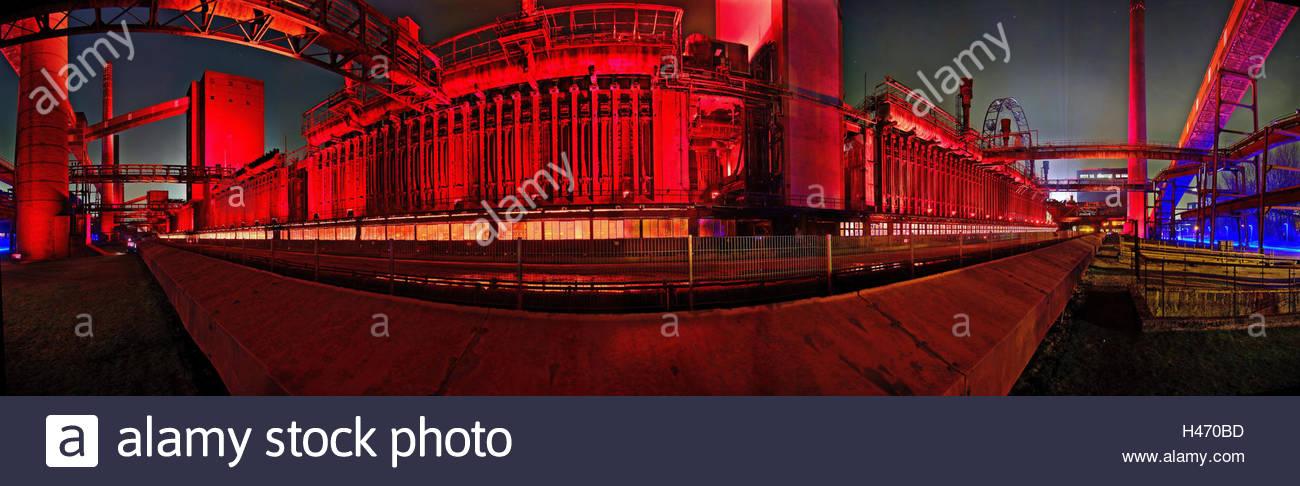 Zollverein Coal Mine Industrial Complex (Zeche Zollverein), old coking plant, illuminated, by night, - Stock Image