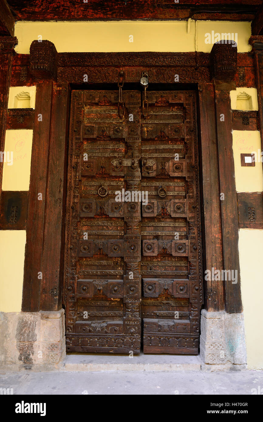 Detail of the decorated door in Ahmedabad of the state Gujarat in India - Stock Image