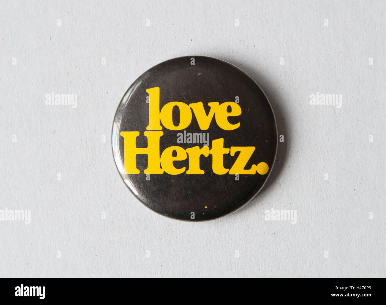 Hertz rental cars, badge collected at car hire 1980s or 1970s 'Love Hertz' HOMER SYKES - Stock Image