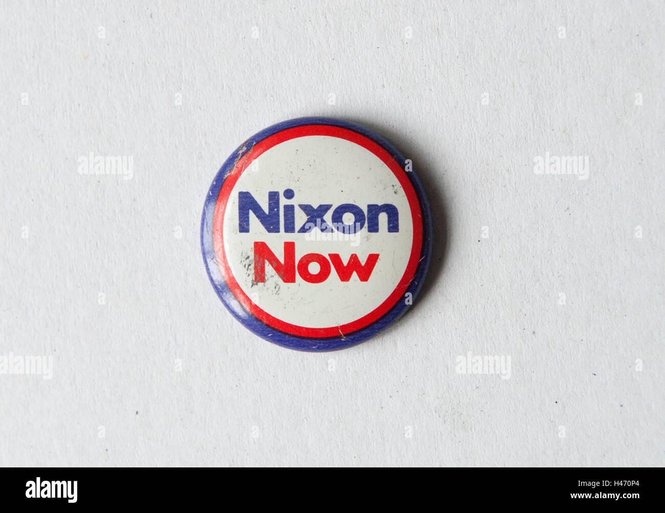 Nixon Now pin button badge Presidential Republican election campaign 1972 USA HOMER SYKES - Stock Image