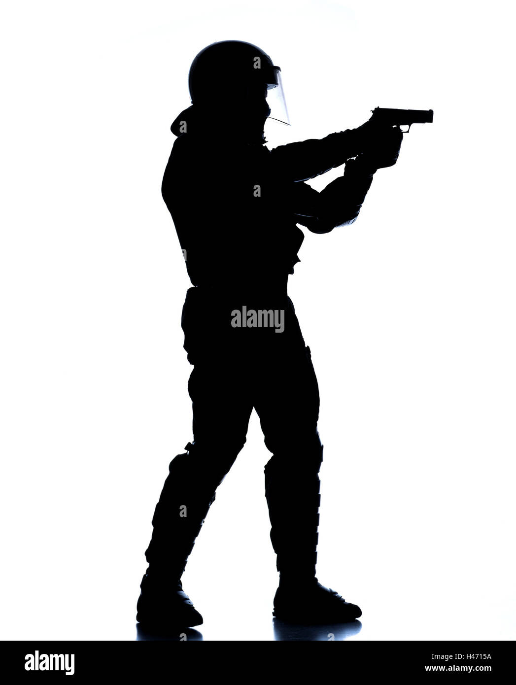 Policeman, protective clothing, stand, gun, shooting practise, aim, shoot silhouette, police, occupation, man, official, - Stock Image