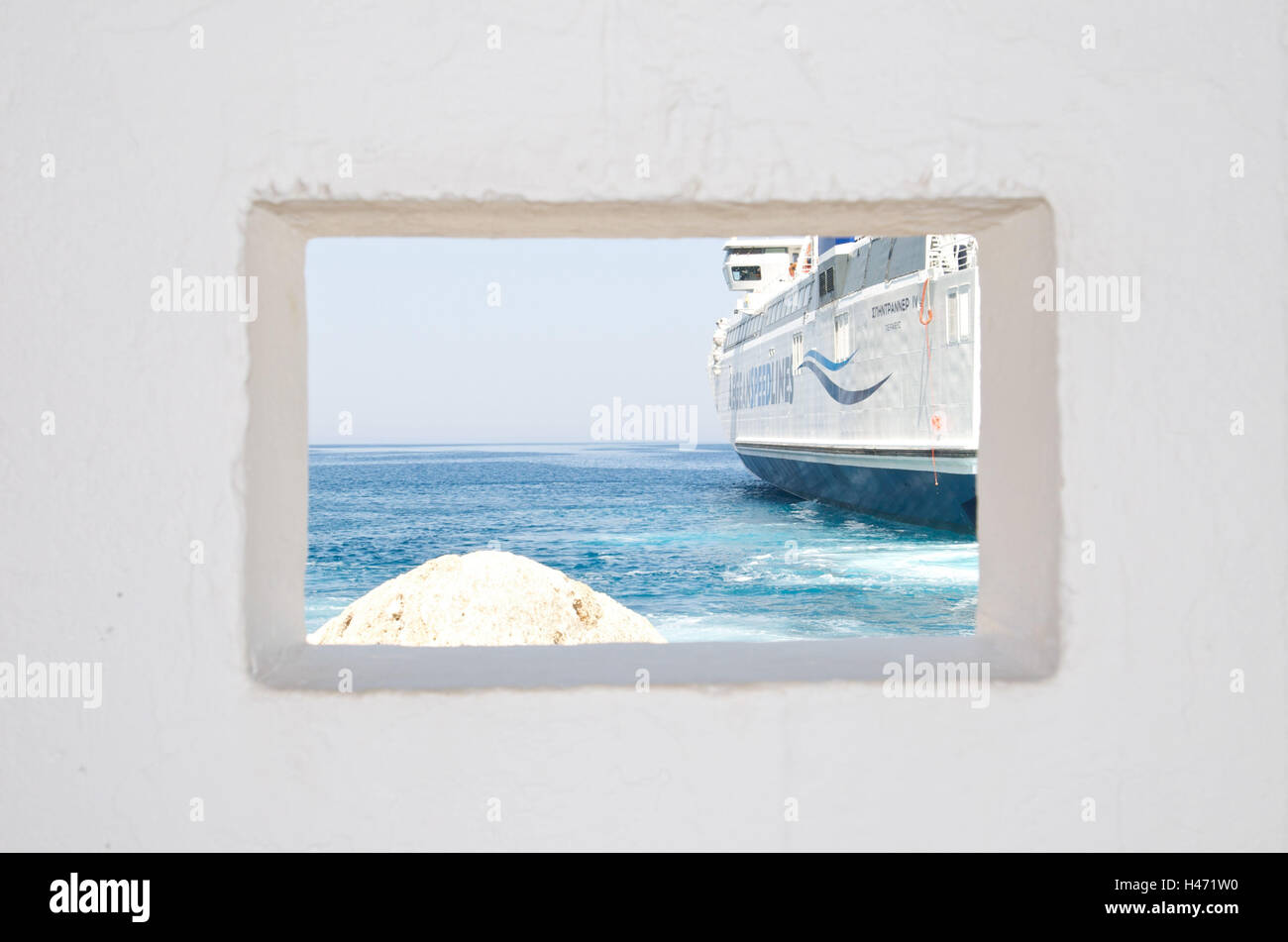 Greece, island Sifnos, harbour, ferry casting off, view through wall, Stock Photo